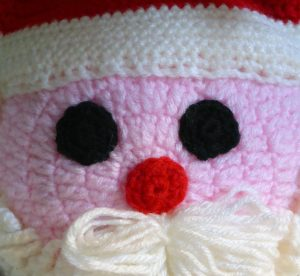 knitted-santa-face-background